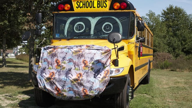 """A school bus wears a """"mask"""" while parked at Gaudet Middle School in Tiverton."""