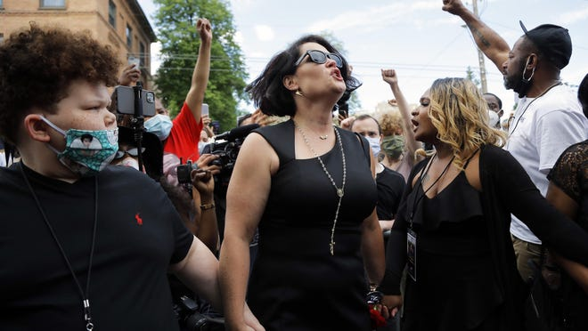 Courteney Ross, the fiancee of George Floyd reacts after a memorial service for Floyd at North Central University Thursday, June 4, 2020, in Minneapolis.
