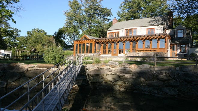 Cathy Hickey's Larchmont Manor home sits on a private, protected cove on Long Island Sound. It's a wonderful spot for kayaking and swimming, and 8-foot tides keep the water clean.