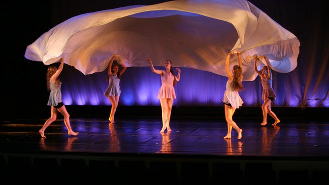 "Dancers in Mamaroneck High School's Performing Arts Curriculum Experience program perform ""Soaring,"" a 1920 dance piece conceived by modern-dance pioneers, as part of ""Kinesthesia,"" a dance recital that has been a Mamaroneck tradition for 40 years."