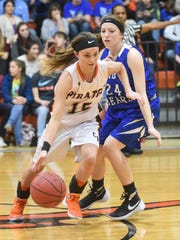 Calico Rock's Kelsey Fry (15) drives past Mammoth Spring's