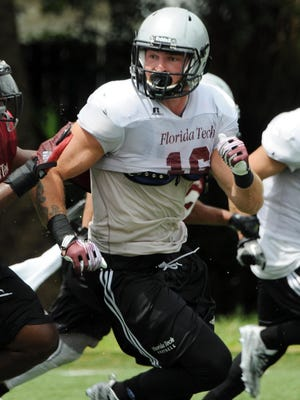 Tight End Gabe Hughes (16) runs a pass pattern on the practice field at Florida Tech.