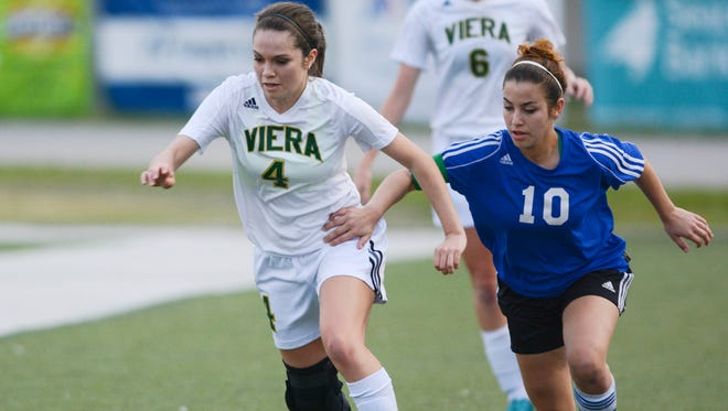 Viera's Sarah Kelliher (4) and Taylor Lawless of Heritage battle for the ball during the District 6, Class 4A tournament at Melbourne High School.