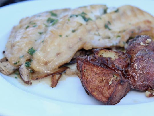 Snapper in rosemary sauce with roasted potatoes at