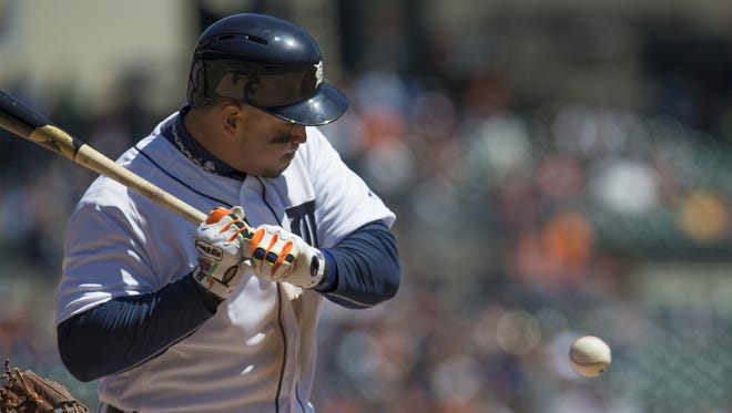 Miguel Cabrera #24 of the Detroit Tigers takes an inside pitch in the fourth inning during a MLB game against the Cleveland Indians at Comerica Park on April 23, 2016 in Detroit.