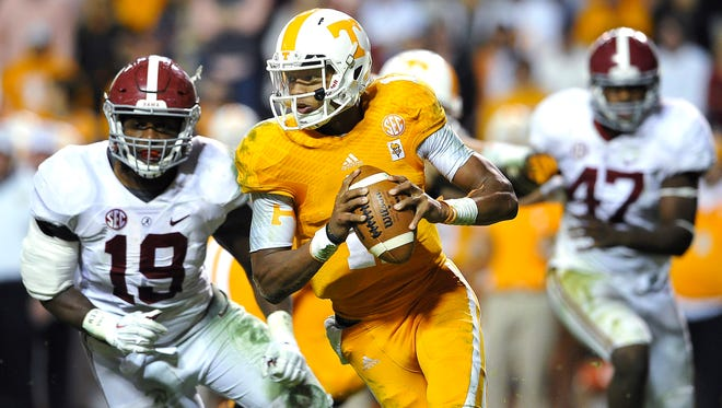 Tennessee quarterback Joshua Dobbs (11) scrambles as the University of Tennessee plays Alabama at Neyland stadium.Saturday Oct. 25, 2014, in Knoxville, TN.