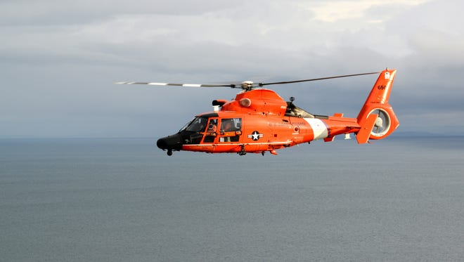A Coast Guard MH-65 Dolphin helicopter crew from Air Station Port Angeles flies of the Strait of Juan de Fuca, off the coast of Washington, Jan. 26, 2018.