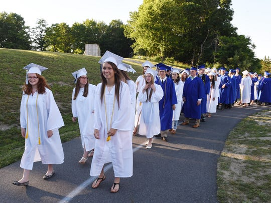 Millbrook High School seniors begin their procession during Friday's commencement.