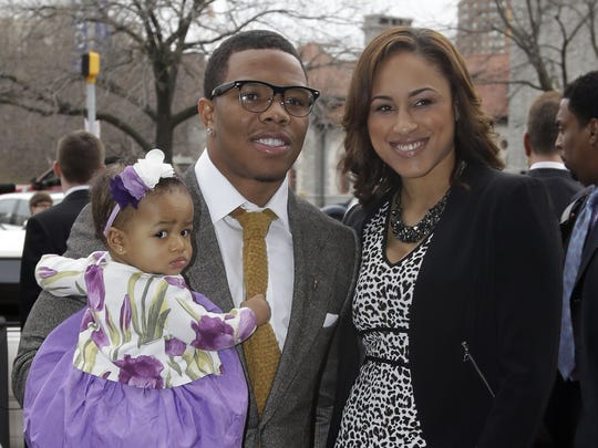 In this March 11, 2013 file photo, Baltimore Ravens running back Ray Rice, left, poses with his daughter, Rayven, and Janay Palmer as they arrive for a screening of a new film released on DVD that chronicles the team's championship NFL football season in Baltimore.