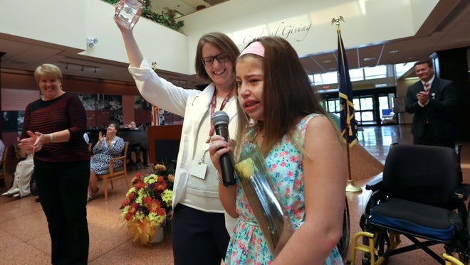 """Ashlin Klev of Airmont says, """"I am the coolest girl ever"""" after receiving the Prize for Pediatric Progress at the Helen Hayes Hospital Honors Assembly in West Haverstraw Sept. 20, 2016. At left is Melissa Mahoney."""