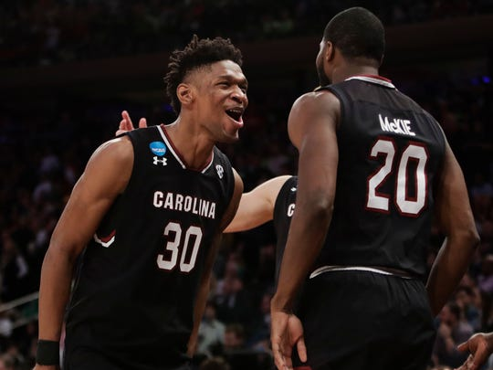 South Carolina forward Chris Silva (30) and guard Justin McKie (20) celebrate as time winds down against Baylor in the second half of an East Regional semifinal game of the NCAA men's college basketball tournament, Friday, March 24, 2017, at Madison Square Garden. South Carolina won 70-50.