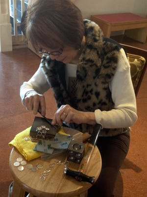 Artist Sharon Major demonstrates techniques she uses in making silver and copper jewelry.