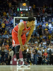 Chicago Bulls guard Derrick Rose (1) reacts in the