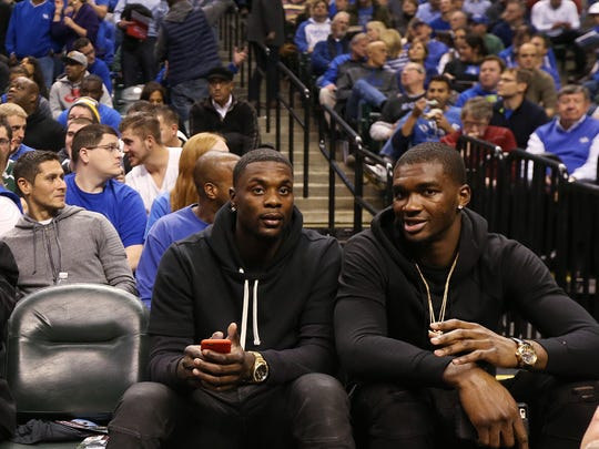 Former Pacer Lance Stephenson, left, sits with former Indiana player and current Charlotte teammate Noah Vonleh courtside at the Kentucky vs. Kansas game at Bankers Life Fieldhouse Tuesday.