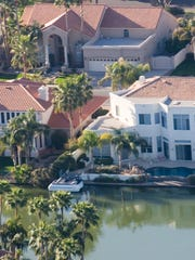 Several residents of Gilbert's Val Vista Lakes are being targeted by their HOA over what it views as negative, critical or defamatory online posts.