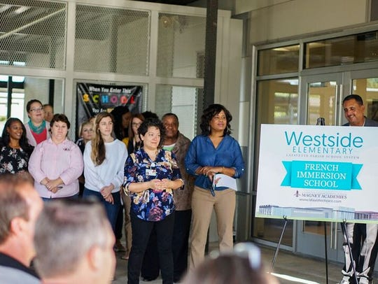 Westside Elementary staff watch the school's ribbon-cutting