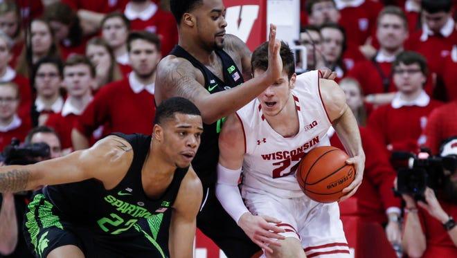 Miles Bridges, left, struggled Sunday at Wisconsin. Understandably so.