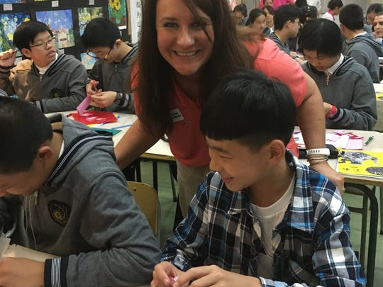 Port Clinton Middle School Principal Carrie Sanchez talks with students at a school in Hangzhou, China.