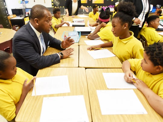 Dr. Theodis Goree, superintendent of Caddo Parish Public Schools, talks to students at Midway Elementary Professional Development School Wednesday afternoon.