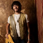 "Chris Janson is pictured on the set of his music video shoot for ""Buy Me A Boat."" Janson will perform a portion of the song on Wednesday's 2015 CMT Music Awards."