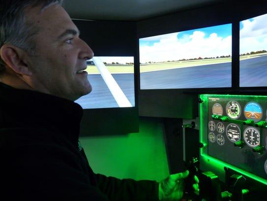 Central Campus aviation instructor Tim Harmer demonstrates