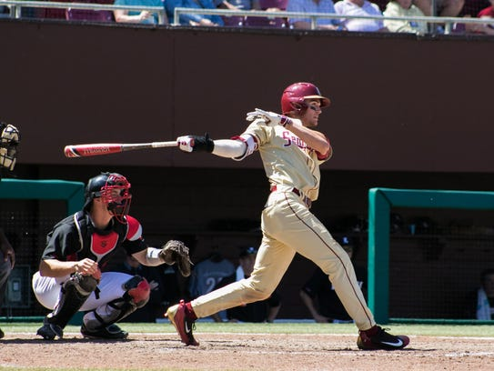Florida State sophomore outfielder Jackson Lueck drives