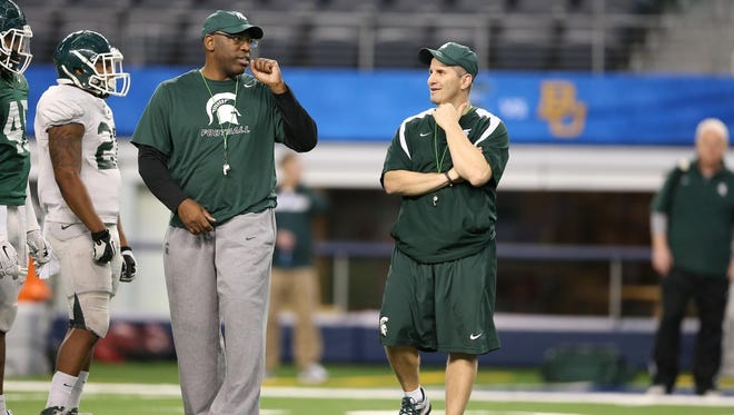 MSU's Harlon Barnett, left, and Mike Tressel will take over as co-defensive coordinators this year.