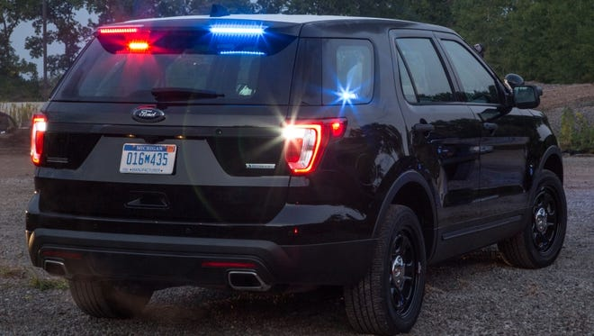 Ford's Police Interceptor SUV gets emergency lights built into the vehicle's rear spoiler