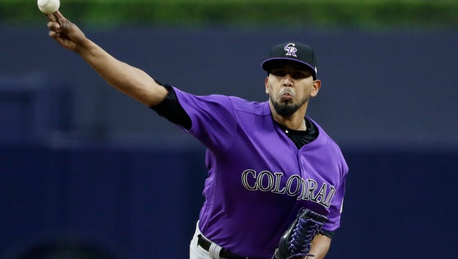 Colorado Rockies starting pitcher German Marquez pitches to a San Diego Padres batter during the first inning of a baseball game Friday, June 2, 2017, in San Diego. (AP Photo/Gregory Bull)