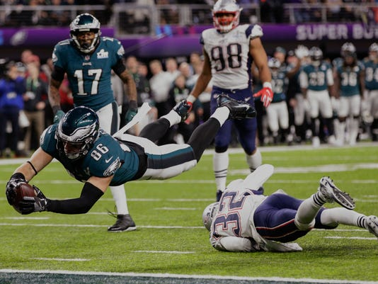 Philadelphia Eagles tight end Zach Ertz (86) dives into the end zone over New England Patriots free safety Devin McCourty (32) for a touchdown, during the second half of the NFL Super Bowl 52 football game against the New England Patriots, Sunday, Feb. 4, 2018, in Minneapolis. (AP Photo/Frank Franklin II)