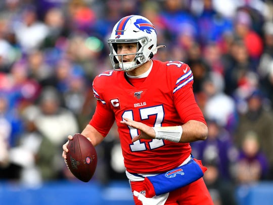 Buffalo Bills quarterback Josh Allen looks to pass during the second half of an NFL football game against the Baltimore Ravens in Orchard Park, N.Y., Sunday, Dec. 8, 2019. (AP Photo/Adrian Kraus)