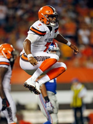 Cleveland Browns quarterback DeShone Kizer celebrates after a 1-yard touchdown in the first half of an NFL preseason football game against the New York Giants, Monday, Aug. 21, 2017, in Cleveland.