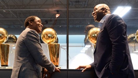 Isiah Thomas, left, and Magic Johnson share stories during the taping of their sit-down interview to air at 11 p.m. Tuesday, Dec. 19 on NBA TV.