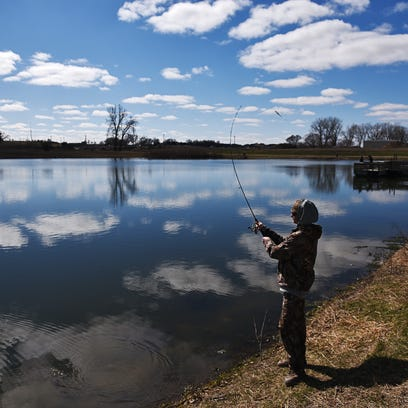 Lane Broker, 16, of Sioux Falls, casts his line into