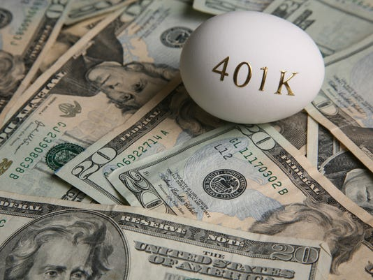 American currency and an egg with '401K' on it