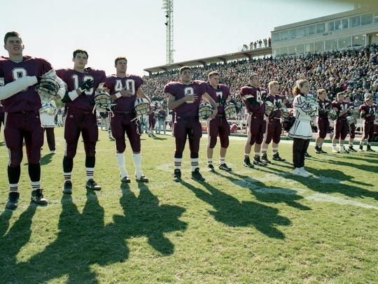 Calallen players line up before the start of the state
