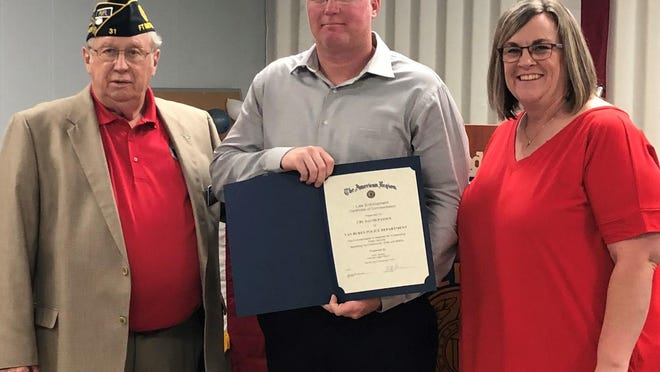 Cpl. David Passen, Van Buren Police Department's Officer of the Quarter, was awarded a certificate of commendation on Nov. 9 by American Legion Post 31 in Fort Smith for his superior leadership and performance. Pictured above are Keith Greene, Cpl. Passen and his wife Angie Passen.