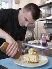 Oleg Scorpan, executive chef and co-owner of Yvonne's in Neptune, prepares an apple cinnamon cheesecake.