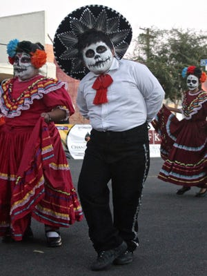 "A group of children perform during the third annual ""Run with los Muertos"" event in Coachella."