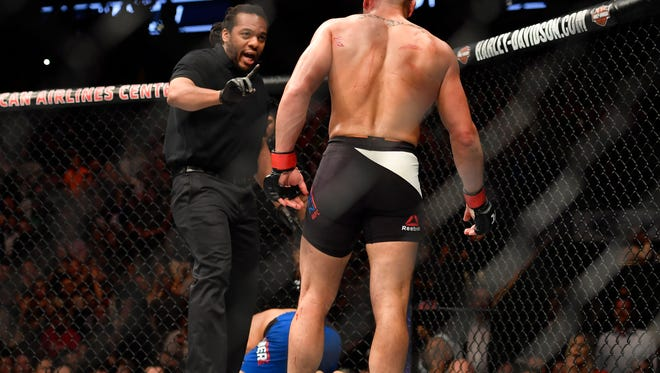 Eddie Alvarez (right) is warned by referee Herb Dean while fighting Dustin Poirier during UFC 211 at American Airlines Center in Dallas.