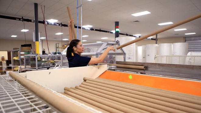 Griselda Flores, an employee at the toilet paper manufacturing line at the South Texas Lighthouse for the Blind, works on the line in the new warehouse and manufacturing facility on Friday, April 7, 2017.