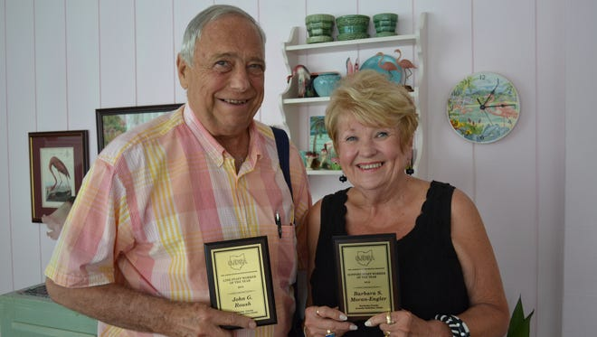 John Roush and Barb Moran-Engler hold the awards they received when they were recently honored for the years they spent volunteering with youth at the Sandusky County Juvenile Justice Center.