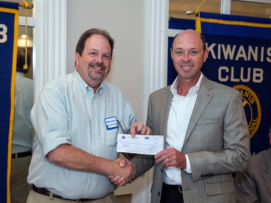 Randy Roewe (right), of the Kiwanis Club of Abilene, presents a $1,000 donation to Mark Young, of the Boys & Girls Club of Abilene.