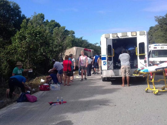 Emergency personal help the victims of a bus accident. Passengers from two Miami-based Royal Caribbean cruise ships, the Celebrity Equinox and Serenade of the Seas, were on board the bus when it overturned on a two-lane highway.