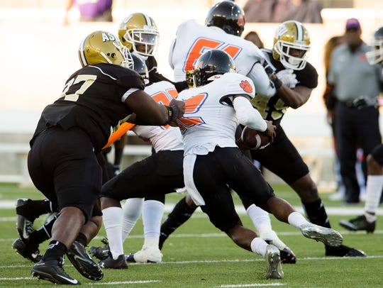 Alabama State defensive tackle Andre Wilson (97) tackles