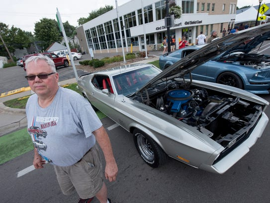 David Rowland poses with his 1971 Ford Mustang Mach