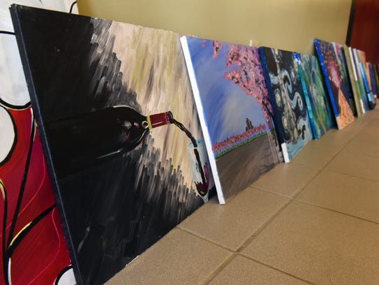 New wine and canvas venue opens in zanesville for Wine and paint indianapolis