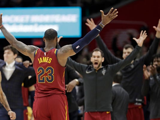 Cleveland Cavaliers' LeBron James celebrates with teammates after the Cavaliers defeated the Toronto Raptors in an NBA basketball game, Wednesday, March 21, 2018, in Cleveland. There has been turmoil and trades, head-scratching losses, injuries and illness. But just when it looked as if LeBron James and this group of Cavaliers were about to buckle with the postseason in sight, an unexpected win may have turned them around. (AP Photo/Tony Dejak)