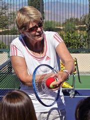 Tennis legends Rosie Casals and Tory Fretz help children improve their tennis skills, Thursday, at the Indian Wells Tennis Garden.