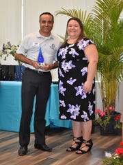 Indian River County Solid Waste Director Himanshu Mehta receives the Sustaining Partner Award from Keep Indian River Executive Director Daisy Packer on behalf of the Indian River County Solid Waste Authority.